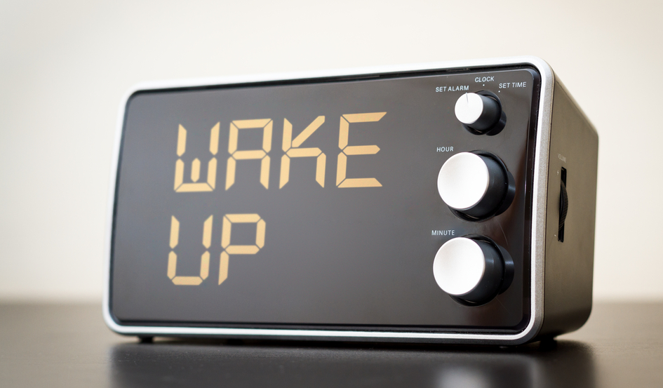 alarm clock which says wake up